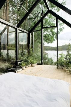 Sleeping in a green house with a lake view...Yes please!
