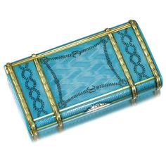 AN ENAMEL CIGARETTE CASE, POSSIBLY RUSSIAN, CIRCA 1905 enamelled in translucent turquoise over undulating engine-turning, the lid and base painted with entwining ribbon-tied garlands within raised gilt laurel bands, rose-cut diamond-set thumbpiece, the end with vesta compartment containing vestas