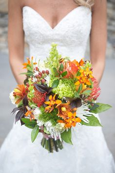 Fall wedding bouquet idea - orange, green and white bouquet with berries, greenery and lilies {Jewels Photography}