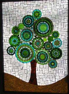 Patchwork Sky is one of my favorite pieces. It is created on a reclaimed window sash. I hand cut each piece of stained glass to create my images. I