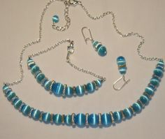 CHAIN AND FIBER OPTIC BEAD JEWELRY SET, necklace, bracelet, dangle earrings, linked, chained, chain, light blue or light teal color, fiber optic beads remind me of tigers eye