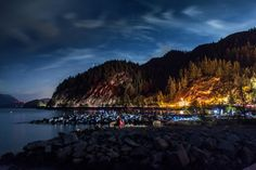 Squamish, Canada. Credit Remy Scalza. Visitors wait for a rare show of northern lights at Porteau Cove, outside Squamish.  An hour's drive north of Vancouver, Squamish has long been a pit stop for the 9.5 million travelers who go to Whistler ski resort each year.