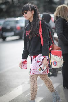 Susie Lau is wearing a Kenzo top and a Loewe pink skirt after the Chanel show during Paris Fashion Week Womenswear Fall Winter 2016/2017 on March 8...