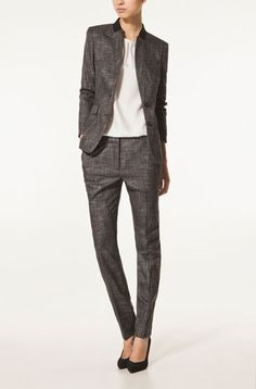 Grey suits are so versatile. Would love this with a sky blue silk blouse