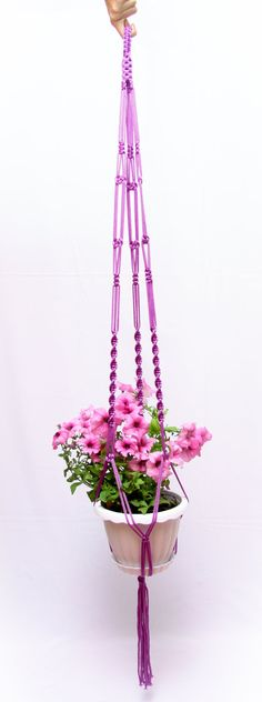 This great handmade macrame plant hanger made with love of strong 5 mm cord.  The pot plant holder is approximately 50 inches (125cm). Length of