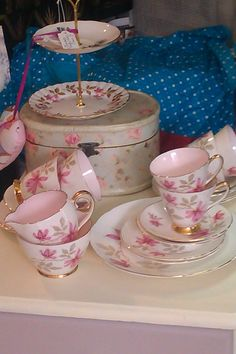 Old Royal 'Pink Floral' 1900-1940 (one cup has a hairline crack) bone china tea set with fabulous baby pink interior and gold edging. 6 cups & saucers, 6 tea plates, large cake plate, milk/cream jug & sugar bowl £40. Two tier cake stand (various designs) £9