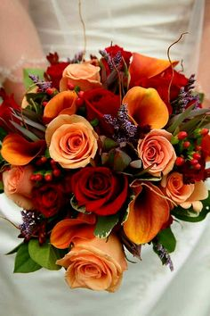 Fall/Autumn Bridal Bouquet Showcasing: Red Roses, Peach Roses, Flame Orange Calla Lilies, Fresh Lavender, Red Hypericum Berries, Safari Sunset, Greenery + Foliage^^^^