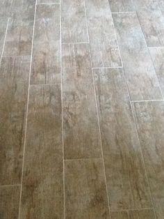 Ceramic tile floor that looks like wood Basement House, Basement Flooring, Tile Flooring, Flooring Ideas, Basement Ideas, Floors, Bathroom Showers, Bathrooms, Beach Condo