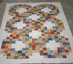 Quilt top made from the Look and Learn collection (jelly roll) from American Jane for Moda. The pattern is from a book called Jelly Roll Quilts by Pam and Nicky Lintott.