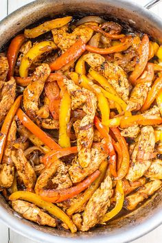Easy 30-Minute Chicken Fajitas - Make restaurant-style fajitas at home in just 30 minutes!! Juicy chicken, caramelized onions, and bell peppers pack so much flavor! This easy recipe will go into your regular rotation!!