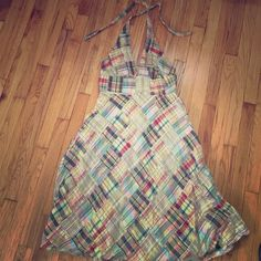 Jcrew halter madras sundress Perfect for summer! 100% cotton with lining, zips up the back, and falls right below the knee. There are a few imperfections - 2 small holes on the front skirt part which came from embers landing on me at a bonfire (not noticeable unless you know they're there), and some discoloration on the inside lining, which I think is from self tanner lotion (not noticeable when wearing). J.Crew Factory Dresses Midi