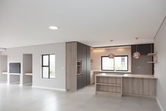 Situated on the Gary Player designed Golf Course of Langebaan Country Estate, this home is the perfect balance of stylish up-market design. Kitchen Grey, Grey Kitchens, Open Kitchen, New House Construction, Copper Lighting, Timber Wood, Table Seating, Country Estate, Large Windows