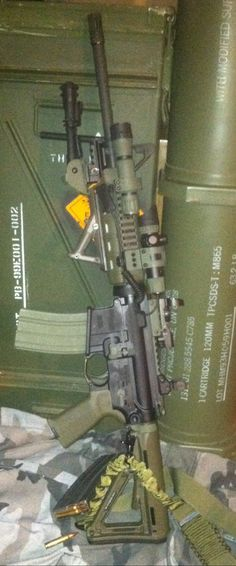 My Sig Sauer M400 5.56 NATO AR-15 with 1000 Lm light, green laser sight, red dot, bipod, and Magpul OD green furniture.
