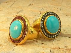 Turquoise rings with silver crowns
