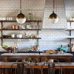 French bistro style - wood shelves, subway tiles to the top, tiled hood. rustic wood island, rustic farmhouse dining table, pendants.