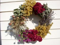 Herb wreath on vine filled with a variety of dried herbs and wildflowers