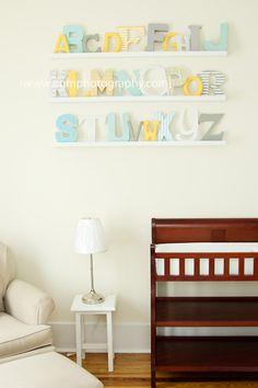 Alphabet nursery, ABC nursery, DIY alphabet - wood and papier mache letters from Michael's and Joann's, some painted and some covered in scrapbook paper. Click on photo for more on blog.