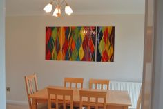 This fused glass art in Nottinghamshire measures 160 cm x 80 cm and is bespoke made by us in a triptych setup. The piece was made according to the wishes of the client, and features a carnivale design. As the client planned to place other matching furniture in the room, the piece was made to match the rest of the room. A great thing about carnivale designs is that they are colourful and feature very strong differences in colour. A splashback like this can light up a room quite beautifully!