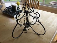 I ran across this candle holder chandelier at the Flea Market.  I just knew what I wanted to turn it into... a Solar Chandelier! I had some Rustoleum Metallic s…