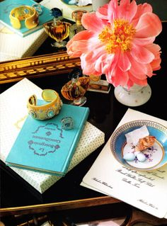 coral. turquoise. book. mirror. gold. yellow. orange. plate. paper. bracelet. flower.