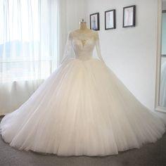 Ball Gown Wedding Dress with 'puffy' tulle skirt, bodice in lace with full sleeves. #WeddingDress #WeddingGown #BridalDress #BridalGown #Brudklänning #Bröllopsklänning #Brudekjole #Bryllup #Kjole #Tailored #Skräddarsydd #SacredFeminineDesign #BallGown #Aline #TulleSkirt #Tyll #SweetheartNeckline #VNeck #HighNeck #FullSleeves #HalfSleeves #OffShoulders #CapSleeves #Lace #Spets #Chiffon #Skirt #LaceUp #Snörning #Beställ #Köp #Order