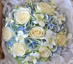 White roses, orchids, and blue hydrangea wedding bouquet+