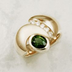 One-of-a-kind gemstone ring, crafted in 14 karat yellow Gold, with a dreamy deep green .98ct. oval Chrome Tourmaline, accented with ideal cut Diamonds.