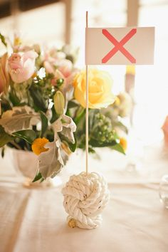 Table name flags were held in place by these delightful nautical knots via Style me Pretty - @Blair Erickson Allyn