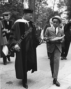 at Oberlin (Oberlin College Archives) Commencement Rev. King stops to sign an autograph.
