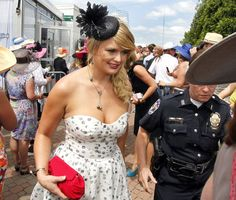 Country music singer Miranda Lambert enters the Downs after making an appearance on the red carpet at the 138th running of the Kentucky Derby at Churchill Downs in Louisville, Kentucky, Saturday, May 5, 2012. Lambert is married to country star Blake Shelton.