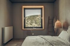 A deep wood window frame showcases the view and acts as a desk. Wood Windows, New Homes, Desk, Mirror, Bedroom, Building, Frame, House, Furniture
