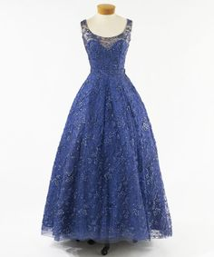 1957-1958  BLUE TANK STRAP, SCOOP NECK EVENING DRESS OF LACE RE-EMBROIDERED WITH BEADS AND SEQUINS