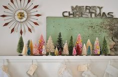 Christmas mantel...love the uniqueness of it all.