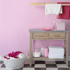 pink utility room. Hmmm... I wonder if I could get away with painting the laundry room pink?