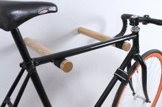 Copenhagen bike rack is the clean and contemporary solution for indoor bike storage. This wall mounted pair of hooks is handcrafted of solid sustainable ash wood with a unique texture. We have provided the notches fixing the bicycle on the rack with a felt lining inside that offer protection
