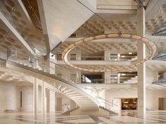 This large helical staircase is situated in Museum of Islamic Art, Doha. By I.M. Pei, photos by Nikolas Koenig