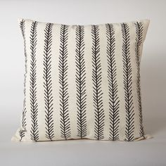 Add flair to your living room with this organic cotton pillow. The graphic pattern is printed onto a cream colored cotton. Mix and match with other graphic pillows or let this one stand alone and make