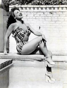 Carmen Miranda    Carmen Miranda on a diving board with her platforms.
