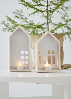 little clay houses with lights.