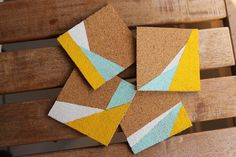 These painted cork coasters use a color-blocked pattern that makes for a quick and easy project with lovely results! // Love the shapes here. Colors are great, too. Cork Crafts, Diy Arts And Crafts, Memo Boards, Painted Wooden Boxes, Cork Coasters, Coaster Furniture, Diy Painting, Diy Gifts, Corks