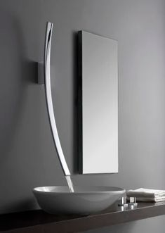 Let the faucet do the talking in your modern bathroom. Check out our 15 favorite modern wall mount faucets - you're guaranteed to find your own favorite! Modern Bathroom Sink, Modern Sink, Bathroom Taps, Modern Bathroom Design, Bathroom Interior, Modern Design, Gray Interior, Modern Faucets, Interior Design