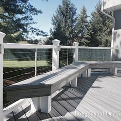 Trex Transcends Deck in Island Mist Color with Trex Rails and Stainless Steel Cable Railings with Shade Pergolas over Outdoor Kitchen Area. Built by Long Island Decking Inc. Mt. Sinai NY