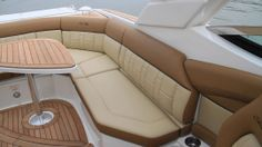 "Sea Ray 350 SLX: Sea Ray calls the pattern on the seat backs ""bracelet stitching"" and it can easily be seen just how intricate it is and how it would be so much easier to keep the upholstery plain. But that wouldn't be consistent with the style and level of luxury of the 350 SLX. Here we have the standard pedestal table instead of the hydraulically actuated table that rises from the deck."