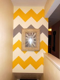 Chevron wall for my bath room except purple instead of yellow