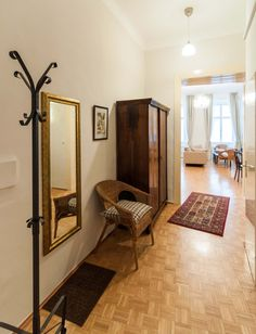 Elegant Vienna Holiday apartment rentals. Musette Apartment, entrance with mirror and antique cabinet.