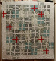 I always wanted to make a plus quilt. Never realized it would look like wrapped gifts at Xmas! Quilt by Amelia Duyvken.