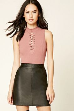 A ribbed knit bodysuit featuring a mock neck, lace-up cutout front, sleeveless cut, and a snap-button closure.