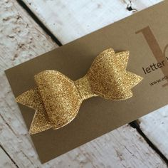 Gold Glitter Hair Bow on Alligator Clip  by letterbdesigns on Etsy https://www.etsy.com/listing/223141799/gold-glitter-hair-bow-on-alligator-clip