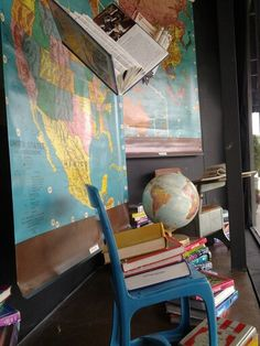 Back to school window at The Shoppes. We never get tired of old maps!