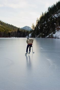 Photo by Zach Bulick. Skating on a frozen lake on New Years Day in Canada.